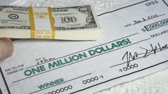 One million dollar checks dollars millionare Stock Footage