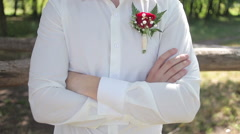 Bright boutonniere in white groom shirt Stock Footage