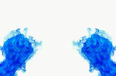 two blue fire flames fist on white background - stock illustration