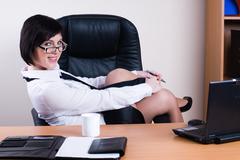 Portrait of businesswoman with organizer - stock photo