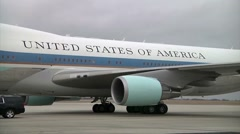 Air Force One on airport tarmac not moving - daytime Stock Footage