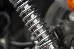 Close up of rusty chrome motorcycle shock absorber Stock Photos