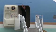 President Barack Obama waves to crowd before entering Air Force One Stock Footage