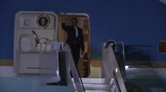 President Barack Obama exits Air Force One and waves Stock Footage