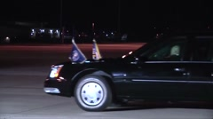 Presidential motorcade passing by at night   President Barack Obama - stock footage