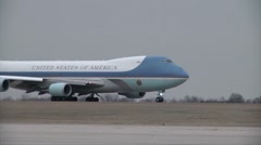 Stock Video Footage of Air Force One  taxis down runway with President Barack Obama