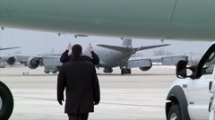 Air Force One ground crew directing plane into position for takeoff Stock Footage