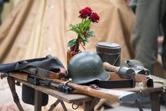 World war 2 equipment - rifle, hand grenade uniform and rose Kuvituskuvat