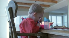 Little boy eating his breakfast Stock Footage