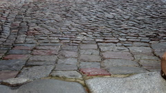 Stock Video Footage of Vertical pan of cobblestone pavement