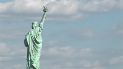 The Statue of Liberty against a cloudy sky. Stock Footage