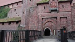 Vertical pan of the gateway to the castle Stock Footage