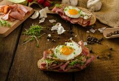 Smoked ham sandwich, rustic bread - stock photo