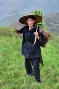 Chinese peasant shepherd wearing cloak an animal skin, rural China. Stock Photos