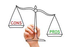 Pros Cons Scale Concept Stock Photos