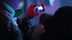 Man Records with iPhone at Music Concert Stock Footage