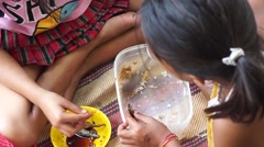 Girls Eating pauper meal together Stock Footage