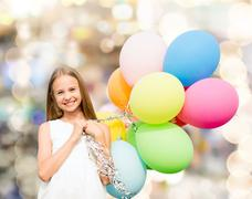 Stock Photo of happy girl with colorful balloons