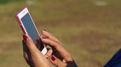 Stock Video Footage of beautiful fingers on mobile cellular phone