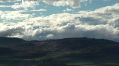 Time-lapse, nice cloud action over ridge, surprise foreground cloud Stock Footage