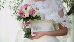 Bride and wedding bouquet - stock footage