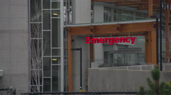 Establishing Shot, general hospital, emergency entrance winter overcast grey day Stock Footage