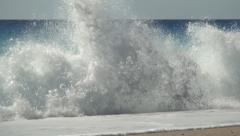 Mediterranean seashore. Big sea waves, blue water, sunshine, blue sky. Stock Footage