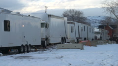 Film set exterior, talent, makeup and wardrobe trailers parked, #3 Stock Footage