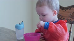 A toddler eating his breakfast Stock Footage