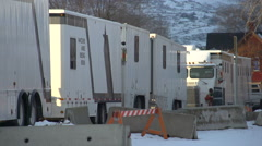Film set exterior, talent, makeup and wardrobe trailers parked, #2 Stock Footage