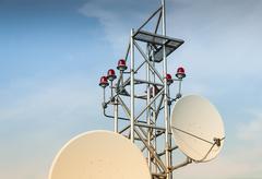 Stock Photo of Satellite antenna on roof