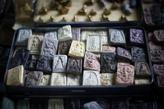 Small Buddha image used as amulet, vignette Stock Photos