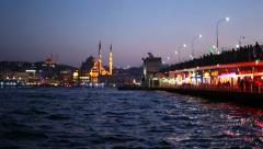 Karakoy point of view with fishermans on Galata Bridge and Istanbul background Stock Footage