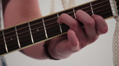 Hippie Girl Playing Chords on Acoustic Guitar Neck Stock Footage