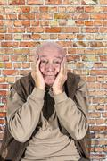 Stock Photo of portrait of elderly man in sorrow
