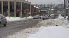 After snowstorm, traffic in town centre, heavy snow Stock Footage