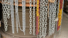 Different type metal, plastic chains and hemp rope coil, tilt Stock Footage
