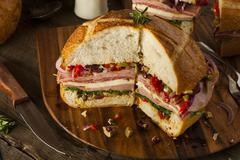 Cajun Muffaletta Sandwich with Meat and Cheese Stock Photos