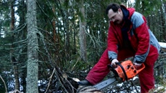 Woodcutter man at work in the winter forest - stock footage