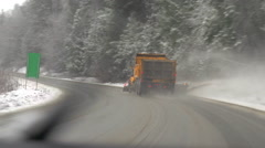 Drive plate, following snowplow on a sloppy snowy highway, #2 Stock Footage