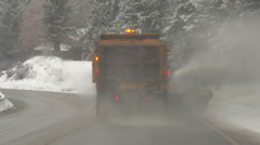 Drive plate, following snowplow on a sloppy snowy highway, #1 Stock Footage