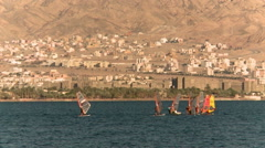 Red sea Arava desert, waves blue sky and windsurging Stock Footage