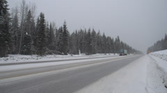transport truck winter highway, through frame - stock footage