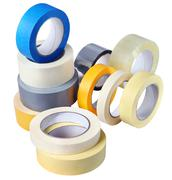 Several rolls of adhesive tapes of different colors, sizes, purposes. - stock photo