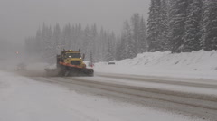 snow plow passing by, Rogers Pass, snowy winter day - stock footage
