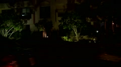 A car travels along a street at night in Los Angeles, California as seen through Stock Footage