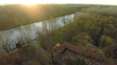 Aerial of Mura river at sunset in winter 4K Stock Footage