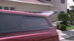 A car travels along a street in Santa Monica, California as seen through the Stock Footage
