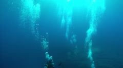 Divers swimming in ocean Stock Footage