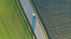 Flying vertically above car driving on road 4K Stock Footage